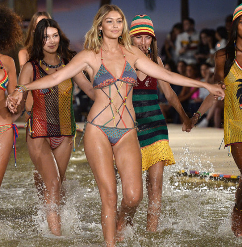 Gigi Hadid and Bella Hadid Get Wet at Tommy Hilfiger Spring 2016 Pictured: Gigi Hadid, Bella Hadid Ref: SPL1125927  140915   Picture by: All Access Photo Group Splash News and Pictures Los Angeles:310-821-2666 New York:212-619-2666 London:870-934-2666 photodesk@splashnews.com