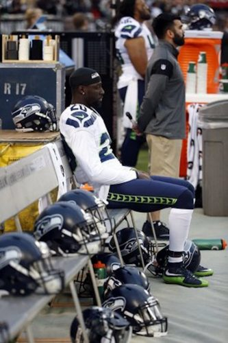 Jeremy Lane sitting during the national anthem in Oakland. Source: Seattle Times