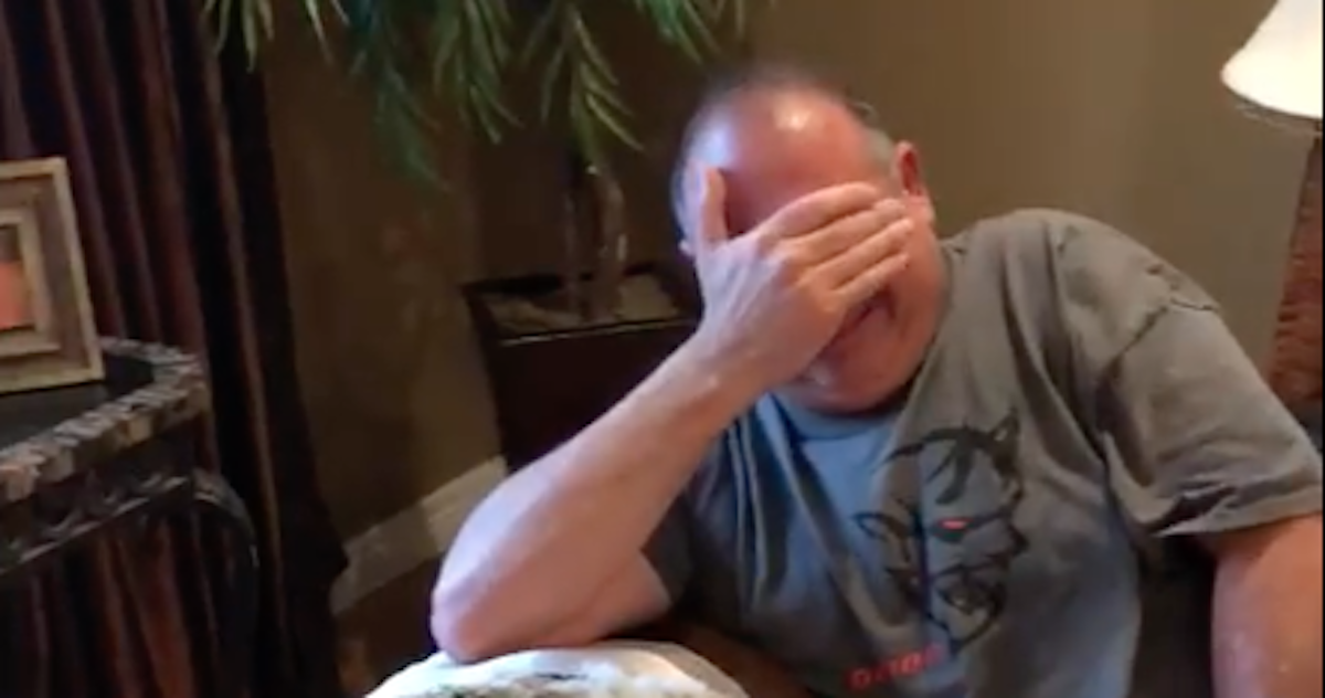 man surprised by puppy